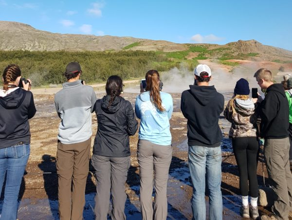 Students on study abroad in Iceland viewing Geysir hotpsring in Iceland