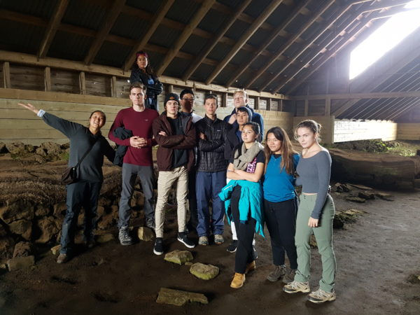 Students on study abroad in Iceland exploring a viking settlers longhouse in Iceland