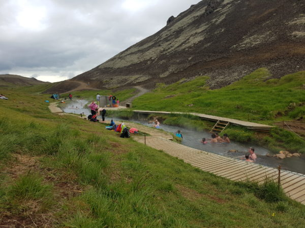 Soaking in a hot river with your local guide on the Golden Circle