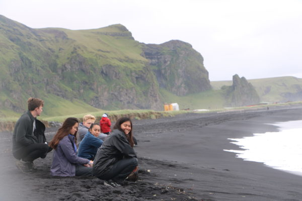 Students on study abroad program in sustainability experiencing geology in south iceland
