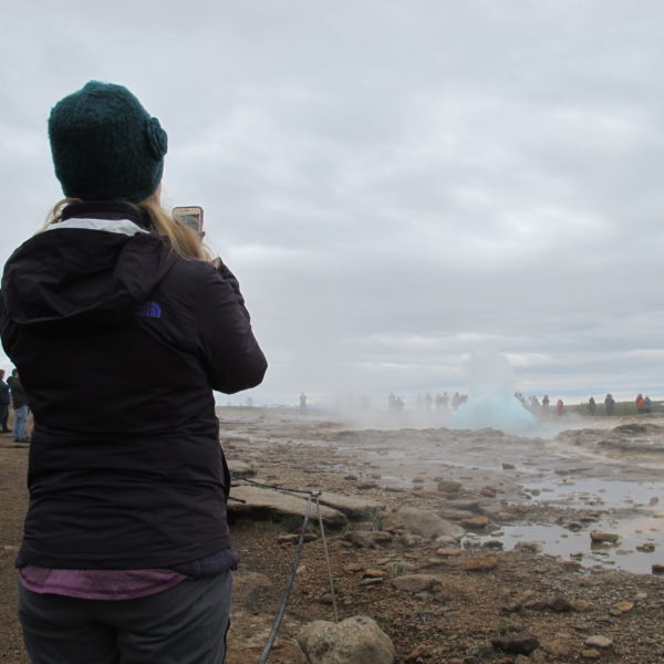 Geysir hot spring with a Golden Circle with a local