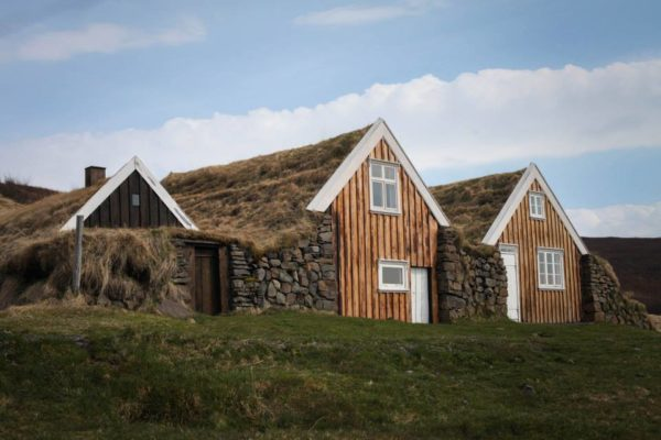 Students on study abroad in Iceland visiting a replica turf house in Iceland