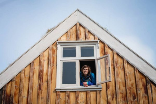 Students on study abroad in Iceland exploring a turfhouse in Iceland