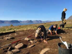 Students on a study abroad program in Iceland learning about archeology