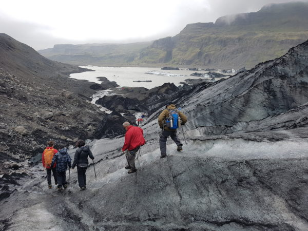 Students on study abroad program on sustainability in south iceland learning about climate change effect on glaciers