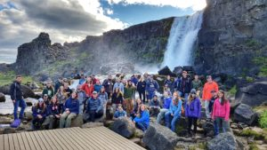 Students on study abroad in Iceland posing by Öxará waterfall at Þingvellir national park